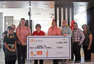McDonald's owner celebrates celebrates Gering remodel with check to school district