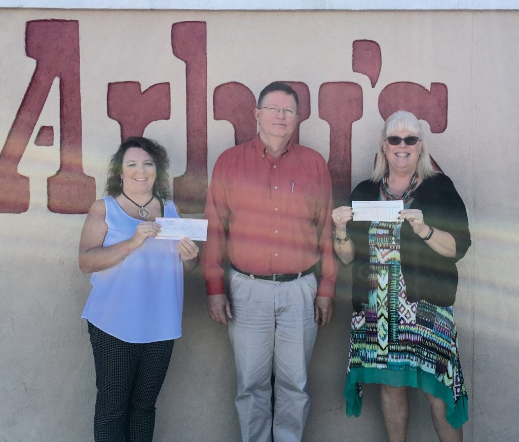 Arby's presents checks to assist with food insecurity programs