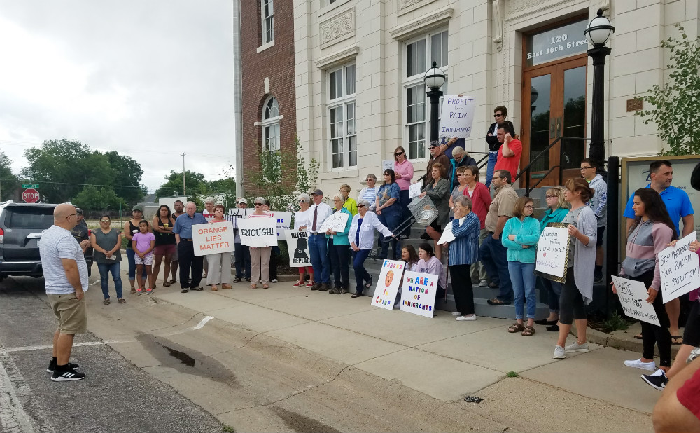 Area community members rally against immigration policy