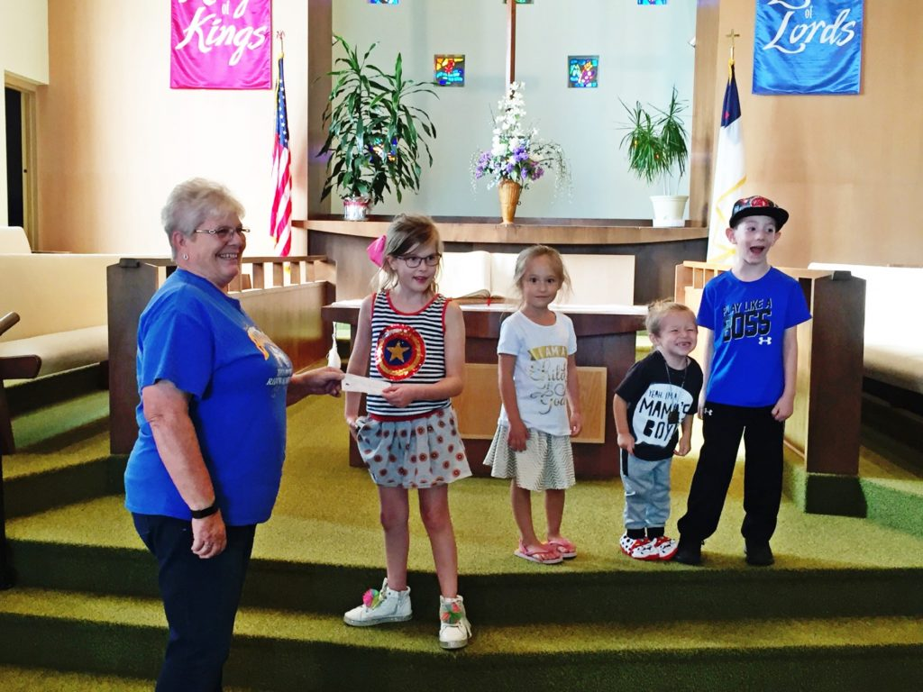 First Baptist Church Vacation Bible School presents missions offering to Buckboard Academy's building project
