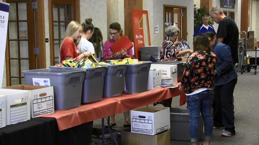 "United Way volunteers sort ""Stuff the Bus"" supplies Tuesday"