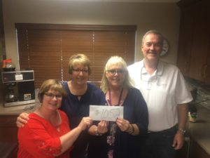Kelley Bean provides donation to United Way Day of Caring