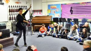Singer/Songwriter Gina Chavez connecting with local students before Thursday concert