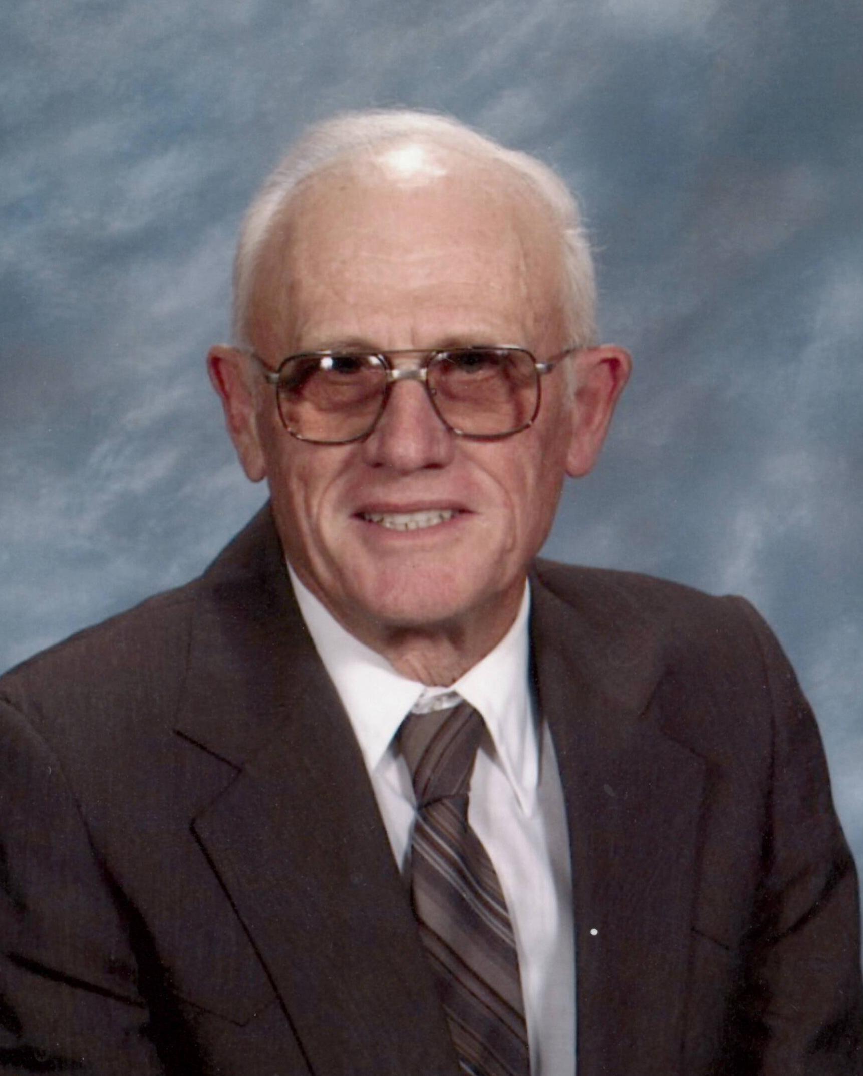 Edward Donald Rebman, 85 years of age, of Alma