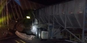 One injured after semi runs into stopped train