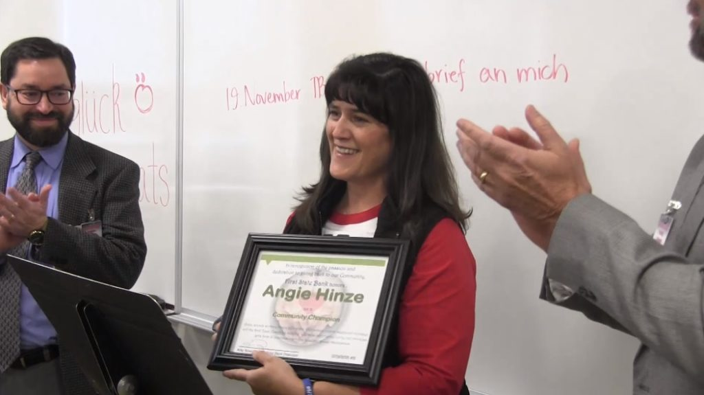 Angie Hinze named First State Bank Community Champion for November