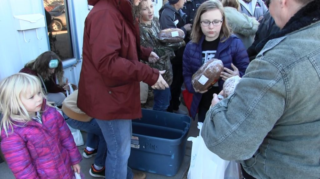 Local effort helps distribute free hams for holiday dinners