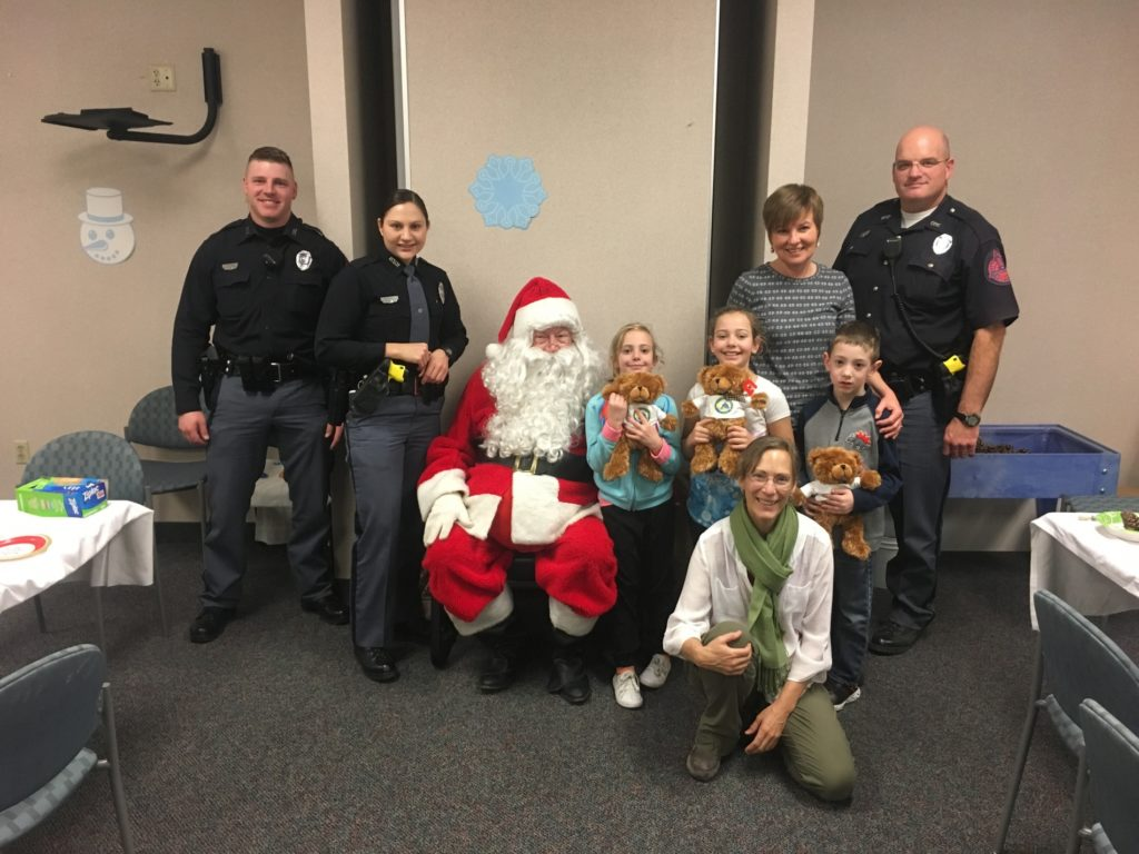 Regional West Foundation Teams Up with NSP Troopers at Christmas Party for Pediatric Rehab Patients