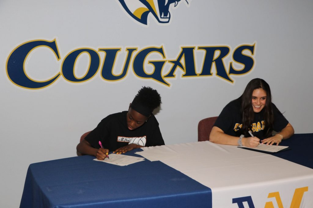 Cougar volleyball players sign with four-year schools