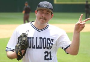 Munsch leads win over Clarke; Bulldogs fall to top seed