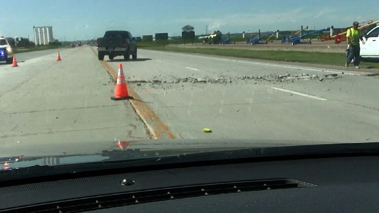 Buckled pavement causes traffic hazard on Hwy 26