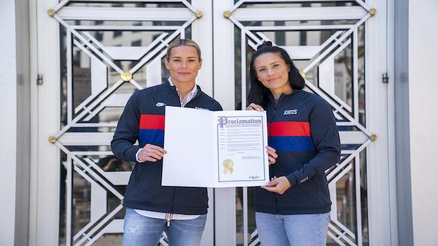 US women's soccer teammates adopt baby daughter