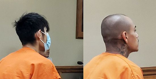 Two suspects arraigned in drive-by shooting death