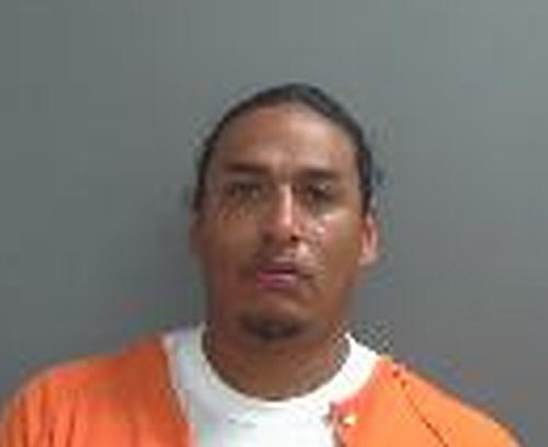 One man charged in Holdrege robbery another sought