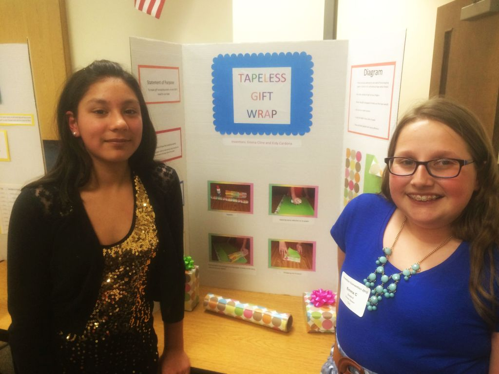 RRN/Ord 6th graders invent Tape-less Gift Wrap. Left, Eidy Cardona and Emma Clein.