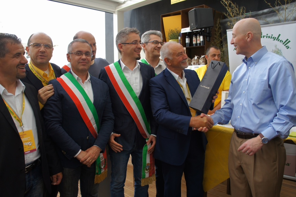 RRN's Jesse Harding. Governor Ricketts presented with some traditional Italian products by the Coldretti.