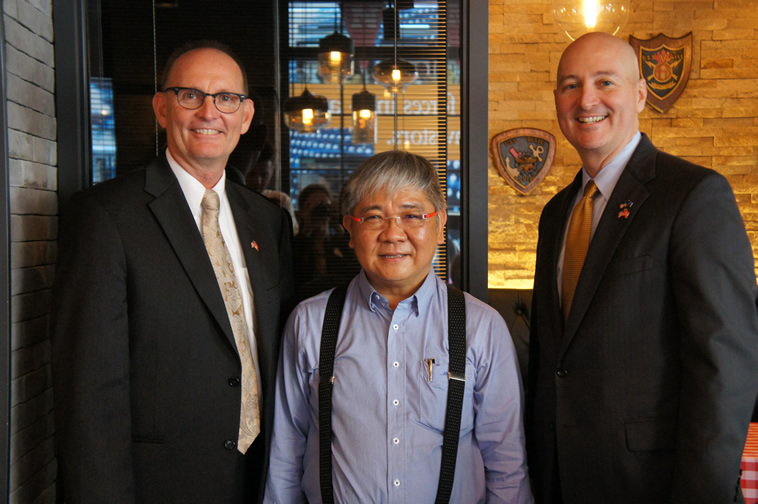 NDA Director Greg Ibach, Nebraska restaurant owner and Governor Pete Ricketts.