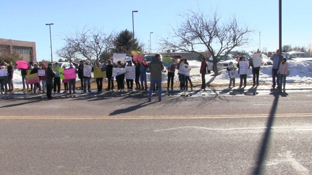 Dozens protest in front of Sen. Fischer's Scottsbluff office over Secretary of Education nominee