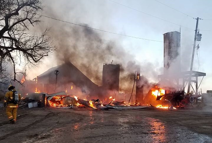 Feedlot fire destroys feed-truck, shop and tractor