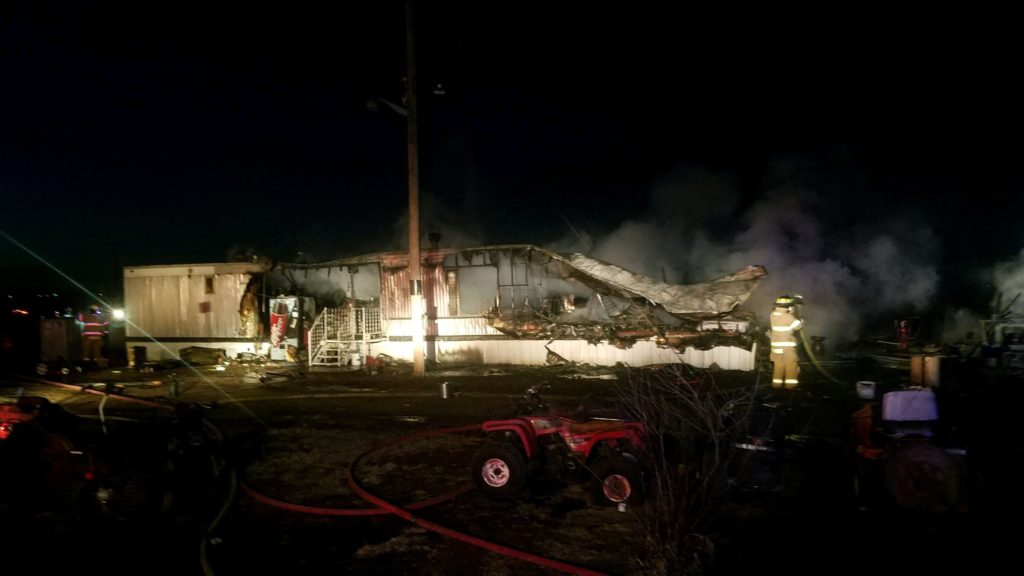 Trailer home and garage destroyed by fire near Cozad