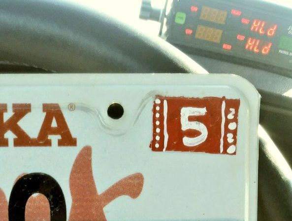 Vehicle had stickers painted onto plates, so driver cited