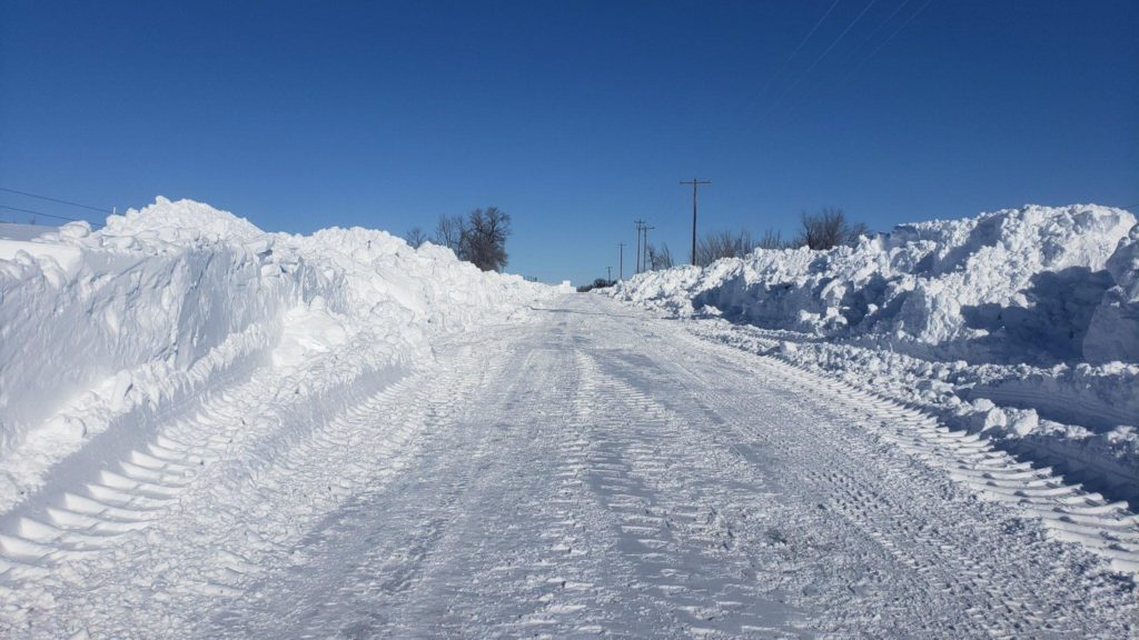 Busting Drifted-In County Gravel Roads Takes Time for Crews