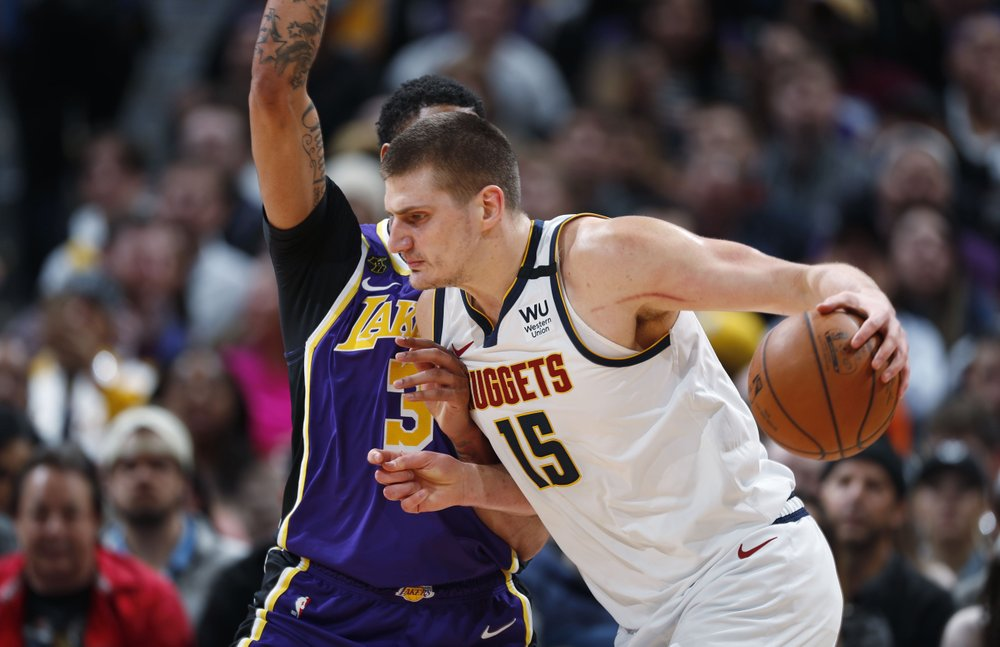 James' triple double, Davis lead Lakers past Nuggets 120-116
