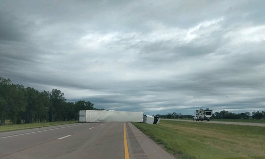 High winds topple semi near Maxwell