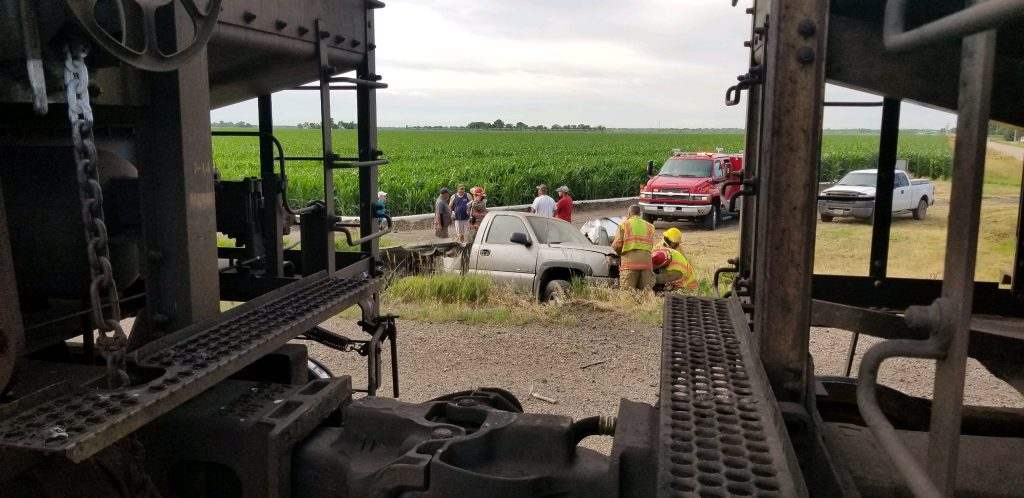 Driver walks away from pickup-train collision