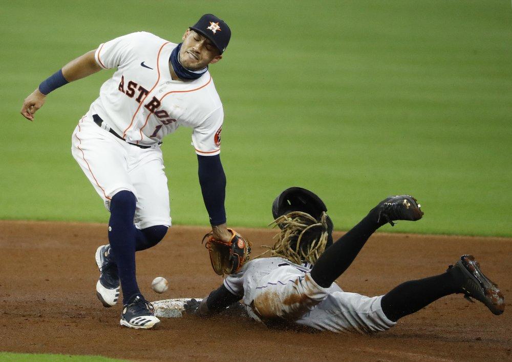 Correa's double helps Astros to 2-1 win over Rockies