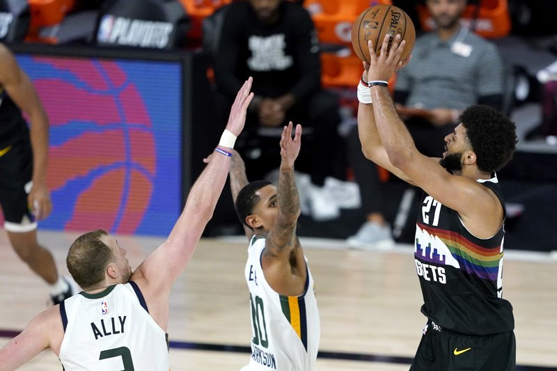 Murray helps Nuggets hold off Jazz, Mitchell 135-125 in OT