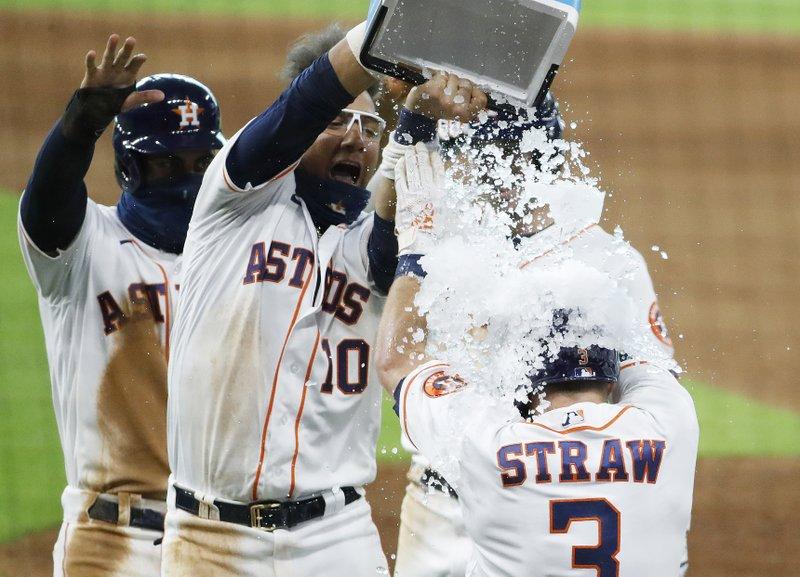 Astros top Rockies in extra innings