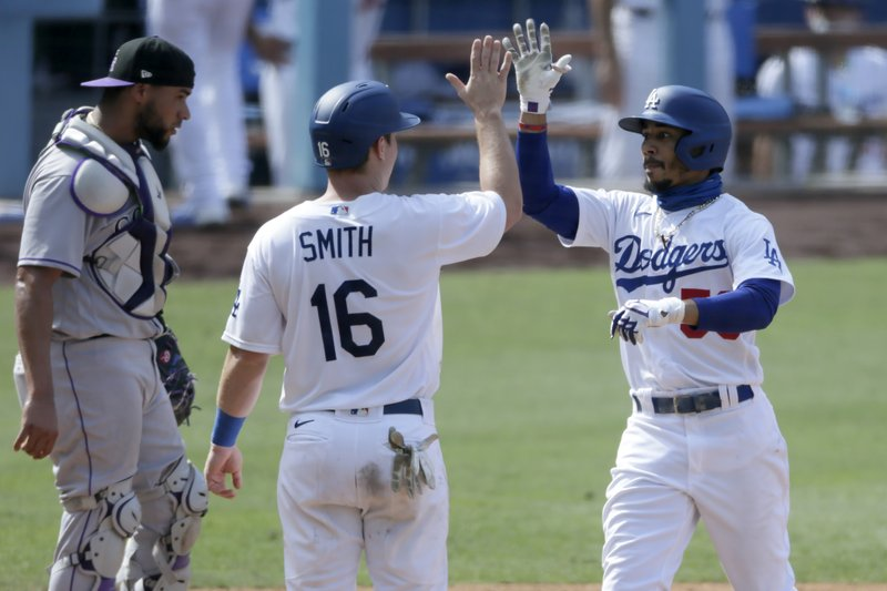 Betts homers twice as Dodgers pound Rockies 11-3