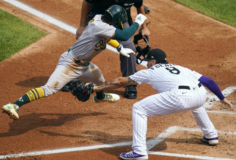 Fiers, lights-out bullpen help Athletics beat Rockies 3-1