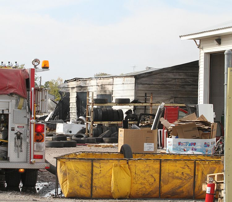 (AUDIO) Fire destroys shed at auto salvage business Friday