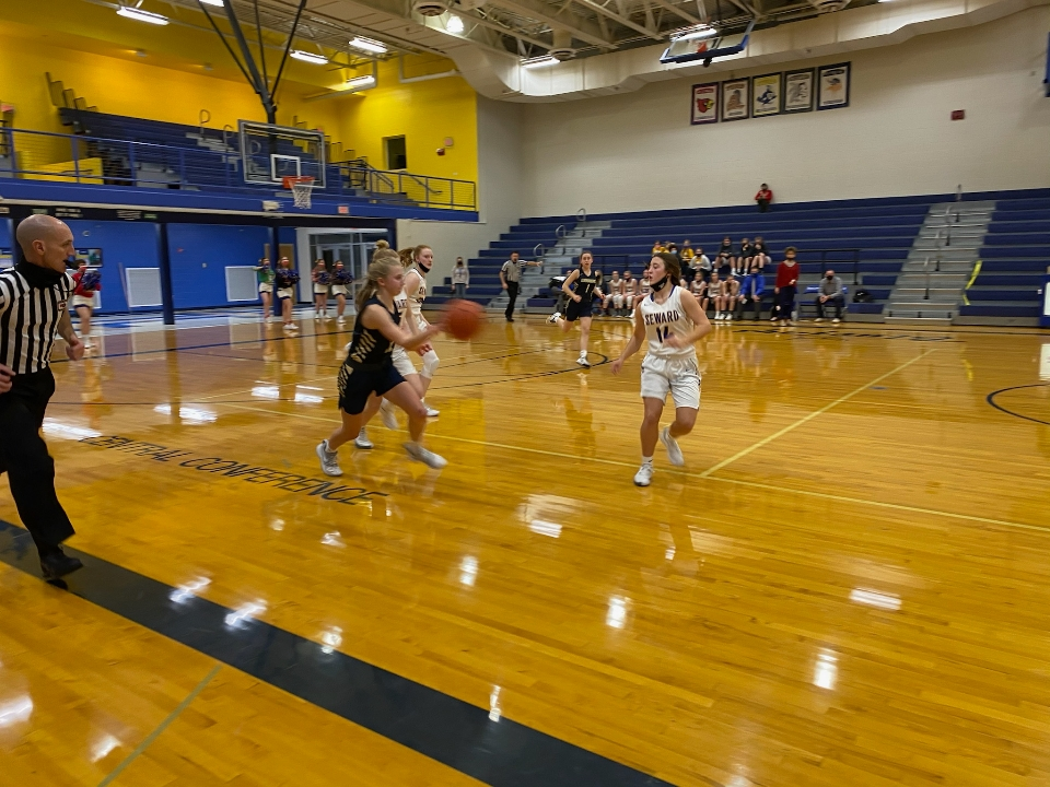 Seward girls and boys fall to Lincoln Lutheran