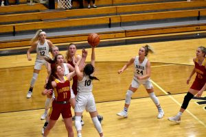 Lady Dukes win district title, head to state