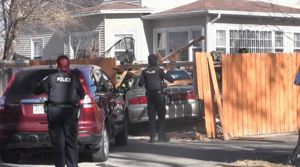 Woman Transported By Ambulance After Crashing Car into Fence