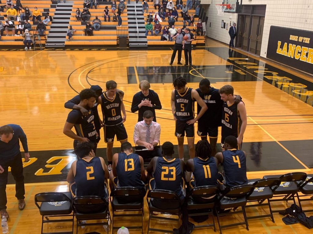WNCC's DeOllos hits late free throws for win over EWC